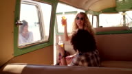 Hipster Couple Sitting in Van toasting and Drinking Beer video