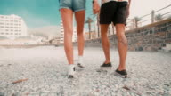 Hipster couple's legs walking in slow motion video