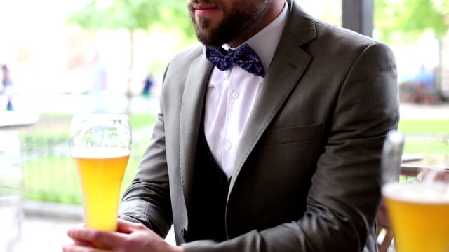 Hipster elegant Business man drinking beer in pub video