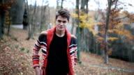 Hipster enjoys autumn video
