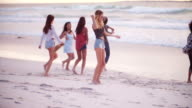 Hipster friends Dancing on Sandy Beach at seaside video