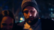 Hipster friends going out together in the city at night video