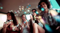 Hipster friends having fun with bubbles inside a vintage van video
