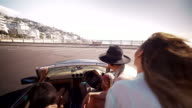 Hipster friends on a convertible at the beach on summer video