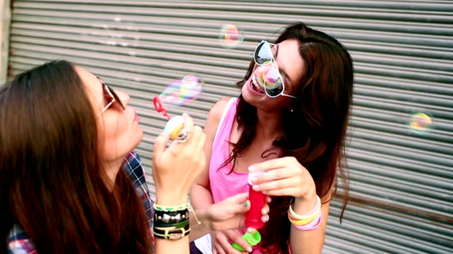 Hipster Friends playing and blowing soap bubbles video