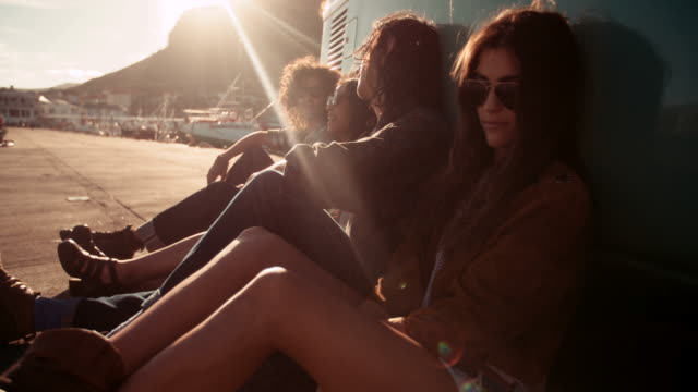 Hipster friends resting out of their van at sunset video