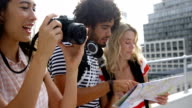 Hipster friends visiting a city and taking pictures video