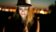 hipster girl using smart phone at night video