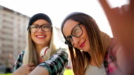 Hipster  girls making selfie video