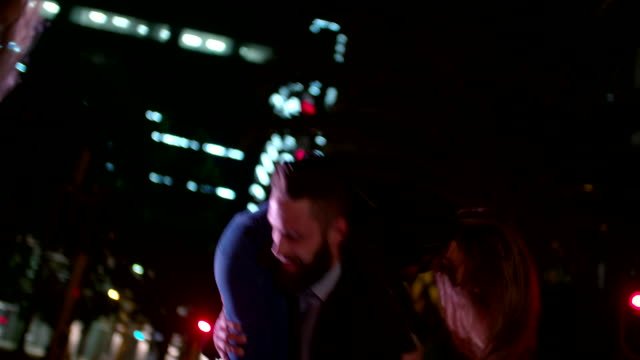 Hipster guy picks his girlfriend up at night in city video