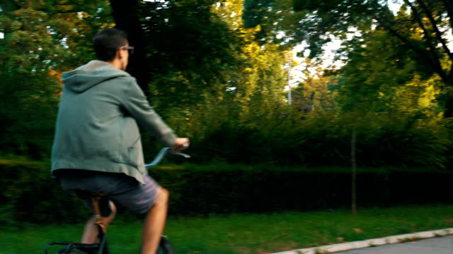 Hipster guy riding his bicycle video