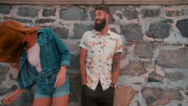 Hipster guy with hipster girl flinging her hair wildly video