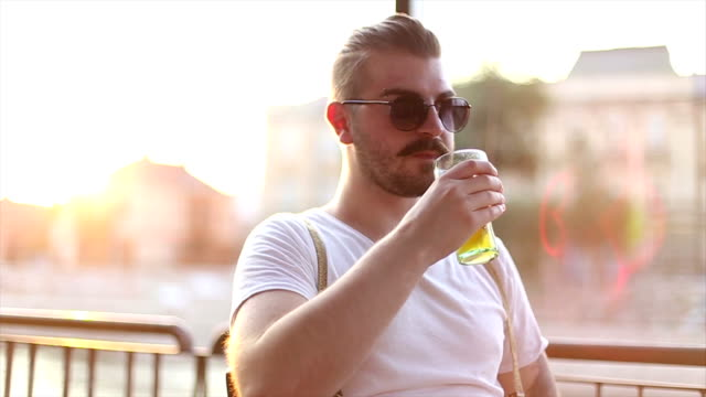 Hipster in a cafe drinking juice video
