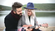 Hipster learns his girlfriend to play ukulele video