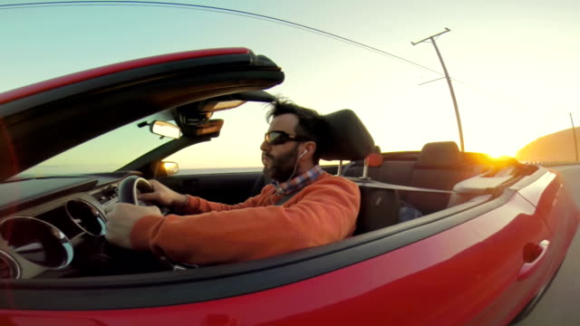 WS POV Hipster Listening To The Music While Driving Convertible video