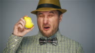Hipster man eating ripe lemon video