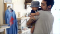 Hipster man holding baby  (4-6 months) video