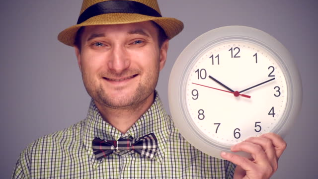 Hipster man pointing on clock video