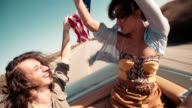 Hipster style teenager friends enjoying a road trip in America video