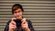 Hipster taking pictures with old vintage camera video