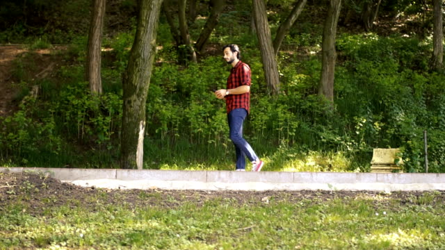 Hipster walking in nature video