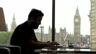 MS Hipster Working On Laptop With Big Ben In Background video