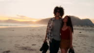 Hipster young couple have a romantic walk on the beach video