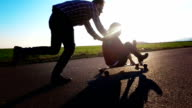 Hipsters having fun on a skateboard video
