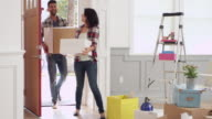 Hispanic Couple Moving Into New Home Shot On R3D video