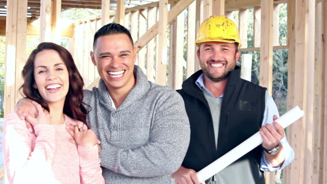 Hispanic couple with contractor, building new home video