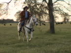Hispanic Cowboy Rides White Horse on Texas Ranch 6 video