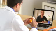 Hispanic doctor explaining prescription to patient video