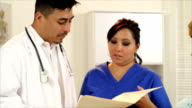 Hispanic Doctor Going Over Findings With Patient video