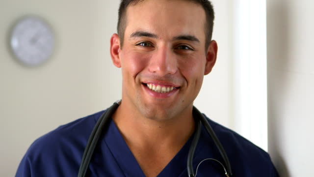 Hispanic doctor smiling in medical office video