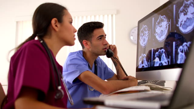 Hispanic doctors working in the office video