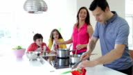 Hispanic Family Cooking Meal At Home video