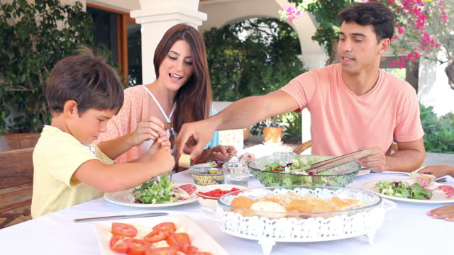Hispanic Family Eating Meal At Home Together video