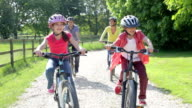 Hispanic Family On Cycle Ride In Countryside video