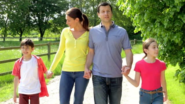 Hispanic Family Walking In Countryside video