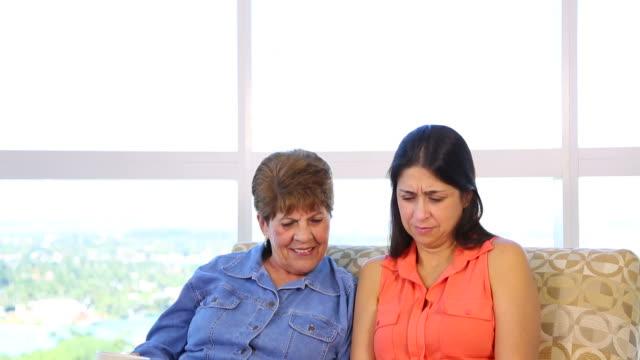 Hispanic latino Mother and daughter on sofa video
