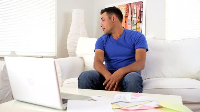 Hispanic man stressed while paying bills video
