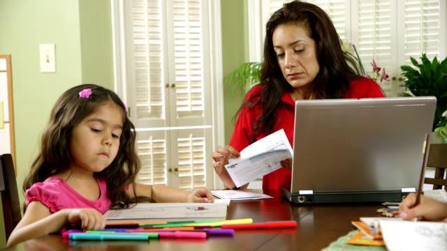Hispanic single mom worries about paying bills video