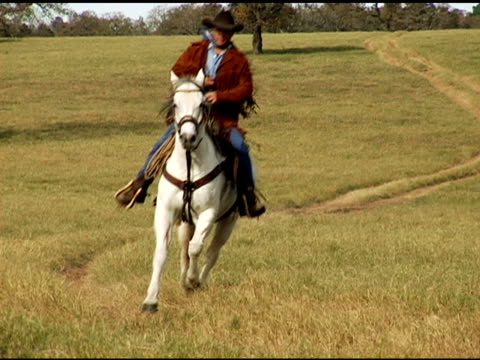 Hispanic Texas Cowboy Galloping on White Horse video