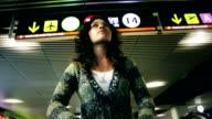 Hispanic woman on the terminal airport video