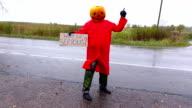 Hitchhiking Pumpkinhead man dance with written sign video