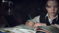 4K Hi-Tech Shot of a Child Doing Homework, changing focus video