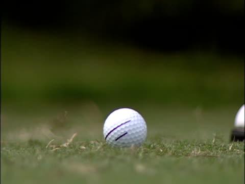 Hitting a golf ball video