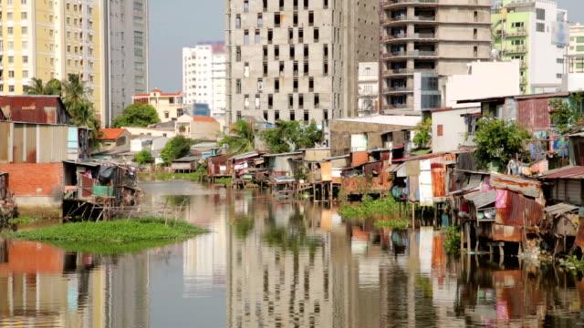 Ho Chi Minh City slums by river, Saigon, Vietnam video