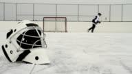 Hockey player shoots puck video