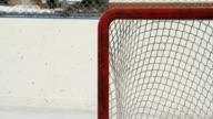 Hockey pucks shot into empty net video